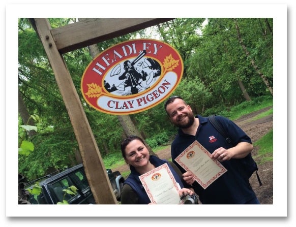 couple holding shooting certificates